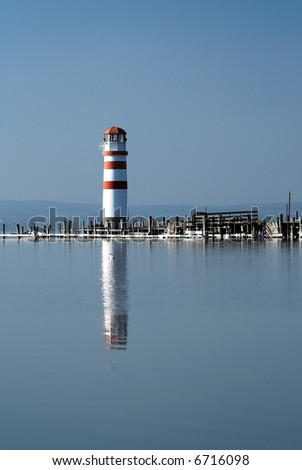 lighthouse with reflection 2. - stock photo