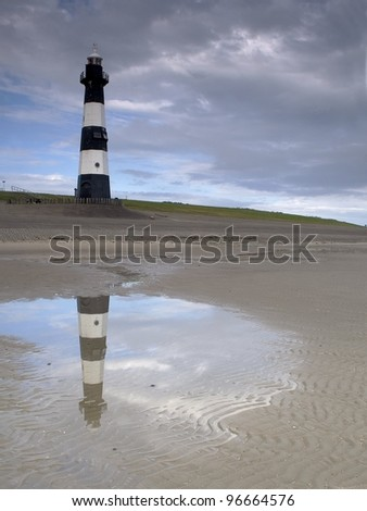 Lighthouse with reflection - stock photo