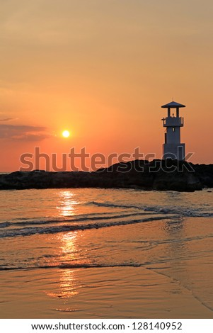 Lighthouse with sunset of thailand sea - stock photo
