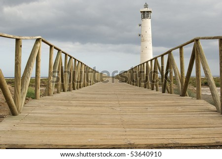 Lighthouse with  wooden footbridge at the beach of Jandia. Fuerteventura. Spain