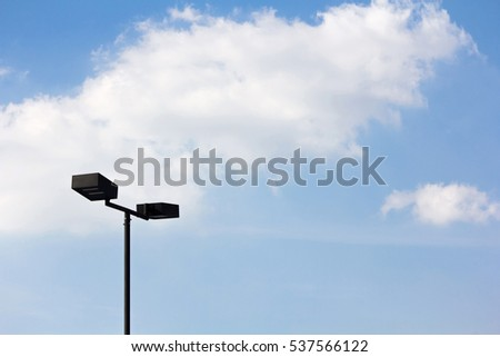 lighting at parking place with blue sky and cloud in background.