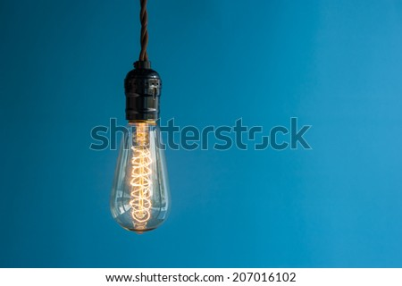 Lighting Decor on Blue Background - stock photo