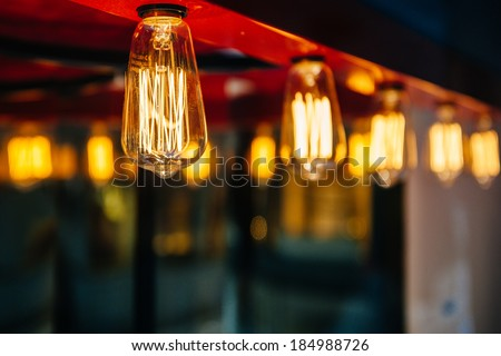 Lighting decoration with vintage bulbs - eclectic interior - stock photo