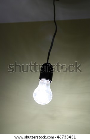 lighting dirty electrical lamp hanging on cable - stock photo