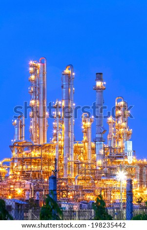 Lighting from structure of oil and chemical factory with blue sky background - stock photo