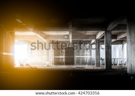 Lighting from window in abandoned building - stock photo