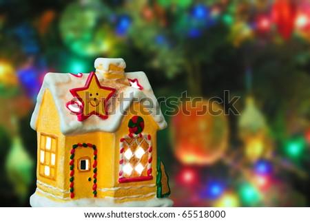 Lighting house - christmas tree on background - stock photo