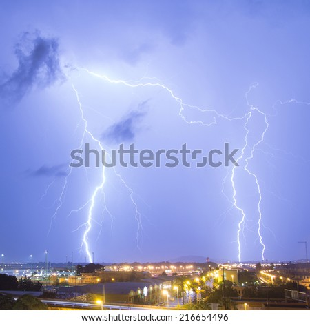 Lighting strikes near the city.