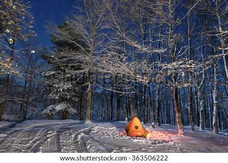 lighting tent in snowy woods of Nebrodi Park, Sicily  - stock photo