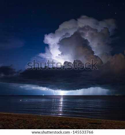 Lightning above the sea in tropical night at the beach.Thailand - stock photo