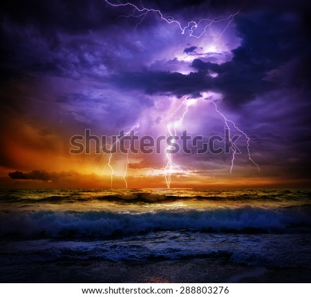 lightning and storm on sea to the sunset - bad weather  - stock photo