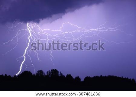 Lightning bolt at night - stock photo