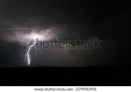 Lightning Bolt from cumulus clouds - stock photo