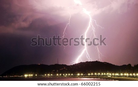 lightning bolt striking the city of santos in brazil - stock photo