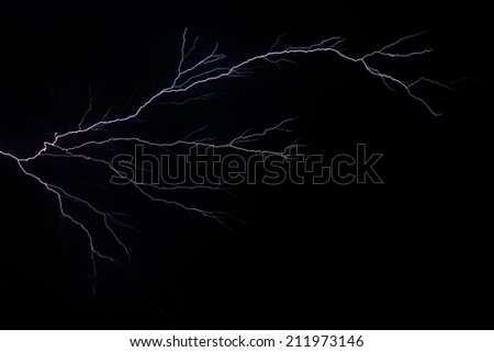 LIghtning branches and forks across a stormy night sky in the American Midwest. - stock photo