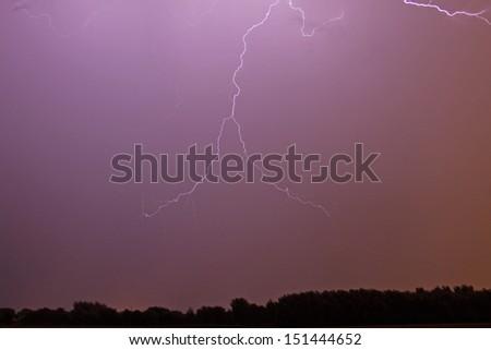 Lightning flash over a corn field - stock photo