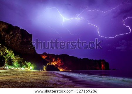 Lightning flashes across the night sky on beach in Thailand, Krabi province - stock photo