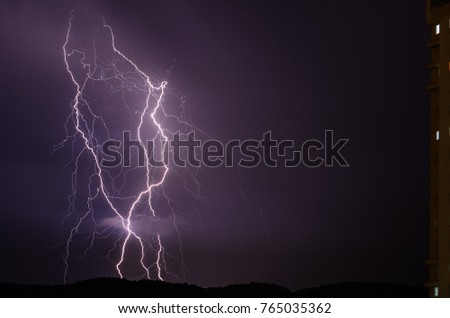 Lightning flashes over Cantareira during a thunderstorm early on September 13, 2015 in São Paulo, Brazil.