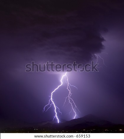 Lightning from an ominous cloud over the desert southwest United States - stock photo
