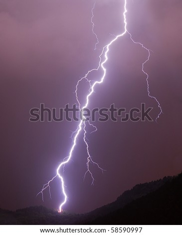 Lightning in a night thunderstorm - stock photo