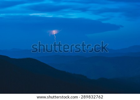Lightning in a stormy clouds above Carpathian mountain prairie - stock photo