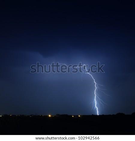 Lightning in a stormy sky - stock photo
