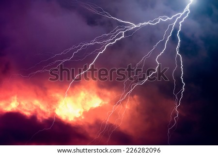 Lightning in Front of a Dramatic Background - stock photo