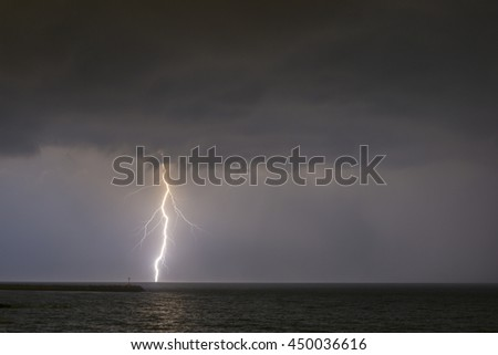 Lightning on the beach at night