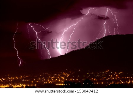 Lightning over city - stock photo