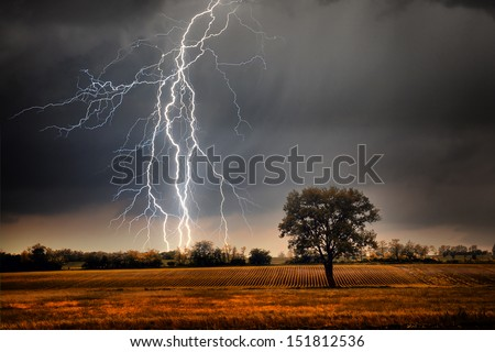 Lightning over field - stock photo