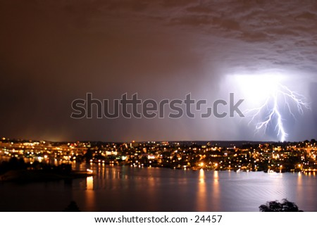 lightning over seattle during a storm - stock photo