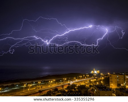 Lightning over the city - stock photo