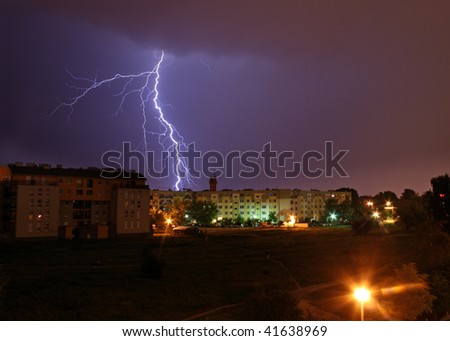 Lightning over the city during the storm - stock photo