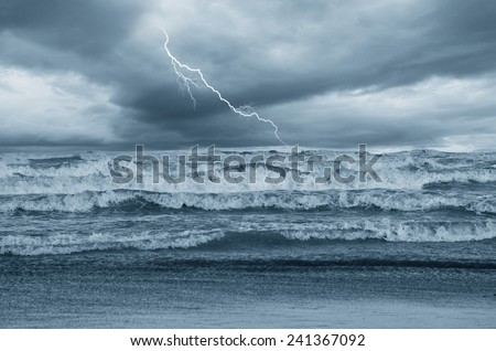 lightning over the stormy sea - stock photo