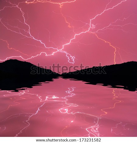 lightning reflected in water - stock photo