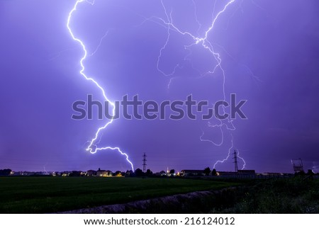 Lightning storm against the city - stock photo