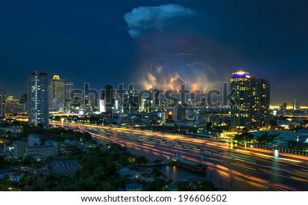 Lightning Storm over Bangkok cityscape river side at twilight in Bangkok, Thailand - stock photo