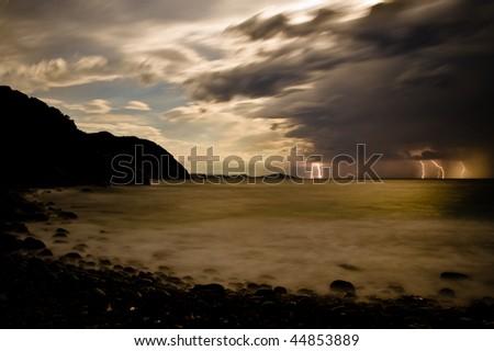 Lightning storm over Bluestone Bay on Tasmania's East Coast - stock photo