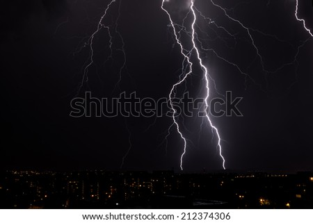 lightning storm over city  - stock photo