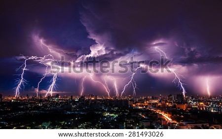 Lightning storm over city in purple light - stock photo