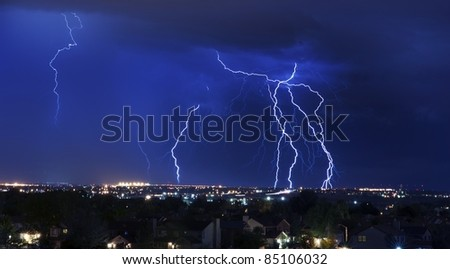Lightning Storm Over South-West Colorado Springs, Colorado, USA. Overnight Heavy Thunderstorm - City, Storm Cloudscape and Few Lightnings. Powerful Nature Photo.