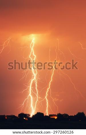 Lightning strike at night - stock photo