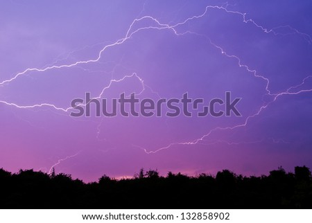 lightning strike in the darkness - stock photo