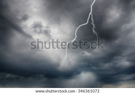 Lightning strike on the dark cloudy sky. HDR image - stock photo