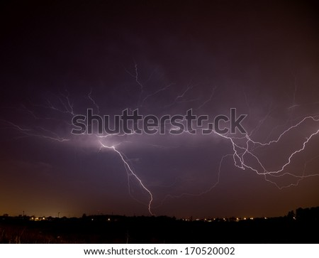 Lightning Strike over Cityscape