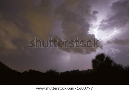 Lightning strike with clouds - stock photo