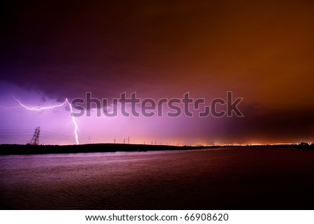 Lightning strikes during electrical storm - stock photo