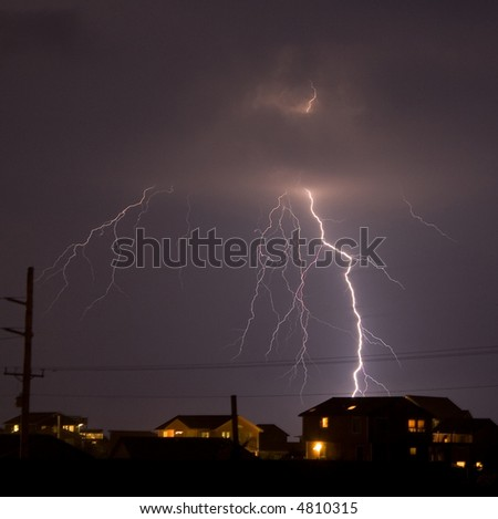 Lightning striking a residential area. - stock photo