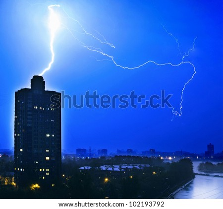 lightning striking the lone tower - stock photo