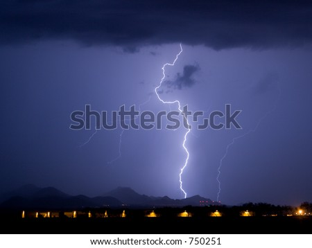Lightning with airplane hangers in the foreground - stock photo